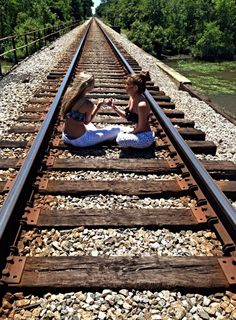 Sitting on the train tracks in are pjs ( Best Friends Forever )