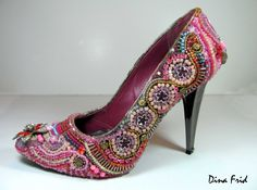 I wouldn't exactly call these pretty as the colors clash to me.  But I love the concept of beading your shoes.