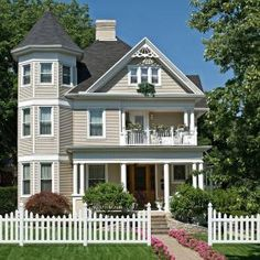 Beautiful Tan Victorian with white picket fence