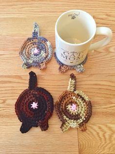 NEW for 2016 - calico colours available!  This is a set of 4 cat butt coasters. Made from yarn, these cute coasters are a great gift for your