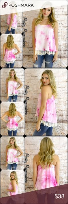 """NWT Fuchsia Pink Tie Dyed Lace Trim Swing Tank Top NWT Fuchsia Pink Tie Dyed Lace Trim Swing Tank Top  Available in sizes: S, M, L Measurements taken from a small  Length: 27.5"""" Bust: 36"""" Waist: 56""""  Features  • spaghetti straps  • fuchsia tie dyed print • cream floral lace scalloped hemline  • relaxed, easy fit • swing, trapeze style fit • sleeveless  • razor back  Cotton blend  Bundle discounts available  No pp or trades  Item # 1/20270380FPT Pretty Persuasions Tops Tank Tops"""