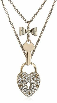 "Betsey Johnson ""Iconic Seasonal Essentials"" Heart Lock and Key 2-Row Necklace Betsey Johnson. $38.00. Gold tone necklace chains, heart lock with crystal accents, bow with key. Items that are handmade may vary in size, shape and color. Gold tone necklace chains, heart lock with crystal accents, bow with key Made in CN. Made in  China"