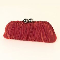 Glamorous and stunning this red satin cinched clutch is perfect to go along with any evening accessory