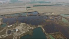 Aerial images show large areas of acid-stained ground in a region pegged for massive investment.