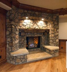 Combining cold and hot elements, a stone fireplace emanates warmth inside your living room. Check out these stone fireplace design ideas to improve the comfort of your home. Fireplace Built Ins, Fireplace Design, Fireplace Ideas, Fireplace Seating, Brick Fireplace, Built In Seating, Living Room With Fireplace, Log Homes, My Dream Home