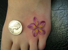 plumeria tattoo - Perfect colors and style. Size and placement is lovely, too.