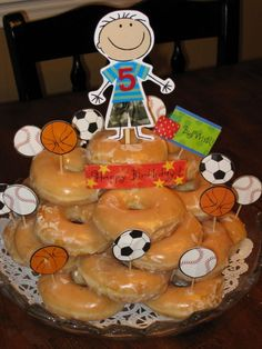 Jenaya doesn't really like cake and has requested a donut cake for her birthday. :) we will do something similar to this but girly of course