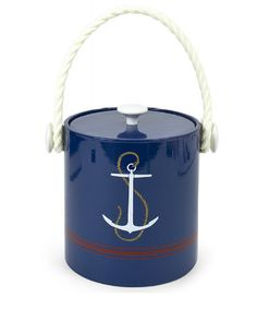 Anchors Aweigh: 23 Unique Finds For Summer Decorating: These Anchor Andirons ($1,250) would add crisp nautical style to a Hamptons beach houses fireplace. : Take your anchors beachside with the Ancre Beach Towel ($25). : Deliver ice for mixed drinks to your poolside bar in this Jonathan Adler Anchor Ice Bucket ($45).
