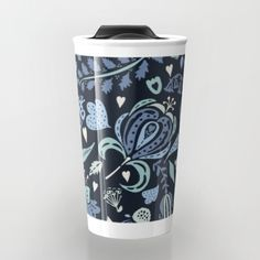 Pretty floral repeat pattern in shades of blue and teal, on a navy blue background.