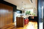Barrow House, Melbourne - Andrew Maynard - how to use black kitchen cabinets with wood  and stainless steel - love the pendant lights.