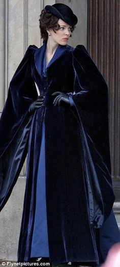 Feeling blue: Rachel started the day in a luxurious velvet coat, before revealing her corseted dress