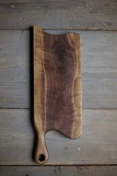 162. Handmade cutting boards with handles made out of black walnut wood