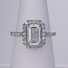 Absolutely stunning! Emerald cut halo engagement ring by Ritani