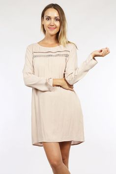 'Creme of the Crop' Dress - This simple dress works for all occasions and transcends well through all seasons with the right layers and accessories. Pair this dreamy loose fitting long sleeve dress with some great brown suede knee high boots and a satchel and you'll be the creme of the crop this Thanksgiving. The delicate lace embroidery detail along the front jewel neckline is sweet and perfect without having to add any extra accessories. Available in Taupe. 100% Rayon.
