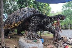 Huge Tortoise Sculpture Emerges from Thousands of Scrap Metal Parts - My Modern Met