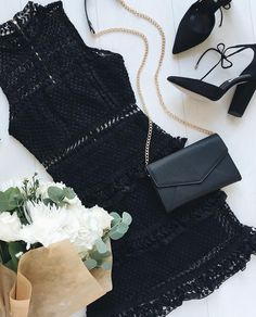 The Name of Love Black Lace Dress will give you butterflies! Stunning crocheted lace with pierced accents shapes a sleeveless bodice with a mock neckline. Waist cutout and tiered skirt complete this flirty look. #lovelulus