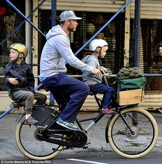 Safety first: Both of Liev Schreiber's young boys wore helmets, one silver and one gold, as they rode the bike