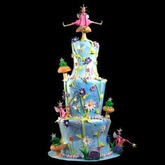 This two tier celebration cake is finished with a image strip with characters from the game, and set of non edible figurines placed on the cake. Description from pinterest.com. I searched for this on bing.com/images