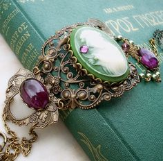 turquoise book covers and beautiful  jewelry bracelet in antique silver, green and purple