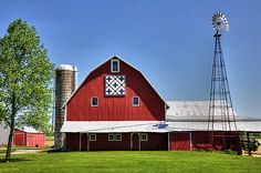 This beautiful quilt barn features a silo and a windmill. It's located in northwestern Champaign County, Ohio on State Route 245.