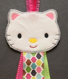 ne machine embroidered kitty felt stitchies barrette or hair clips keeper and holder. This organizer allows you to snap or clip all your favorite hair clips to the ribbon for a neat display!