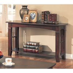 Bring a warm and inviting accent to your home with this cherry finish sofa table. The bottom shelf provides convenient storage.