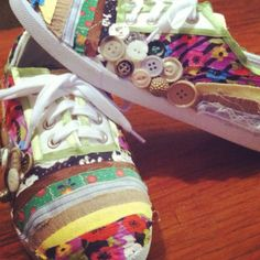 Attempted and accomplished. $5 plain tennis shoes from Walmart, scrap fabric strips and spare buttons. Easy and adorable. :)