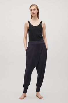 COS image 1 of Oversized drop-crotch trousers in Navy