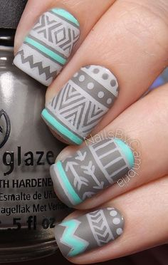 Tribal designs in gray and sea green polish. Complete your winter nail look with these fu looking tribal designs in darker gray hues.