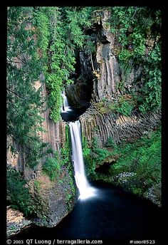 Toketee Falls and Huge Wall of Columnar Basalt, Oregon. Located at the confluence of the North Umpqua River and the Clearwater River. It is about 58 miles east of Roseburg  on Oregon Route 138.