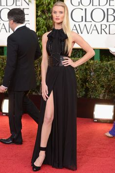 Rosie Huntington-Whiteley in a a Saint Laurent black gown, belt and heels.
