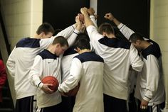 Members of the Penn State basketball team pause before going out...