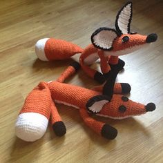 """The finished Fox is about 23"""" from nose to tail. My gauge was approx. 5 sts/inch and 3 rows/inch and I chose to stuff the body and tail rather loosely, legs a bit more firm, but that's your call. I like a floppy Fox. In The Little Prince (the Netflix movie version), Plushy Fox has orange ears with white inside and the black just around the edge. I chose to make my Foxes with just black ears for silly aesthetic reasons, but you can easily sub in your orange for the backs of your Fox'..."""