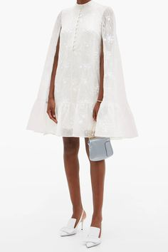 This super chic dress from Erdems is the fall mini wedding dress of your dreams. The romantic bridal cape, embroidered details, and buttoned-up look are perfect for the modern bride. Its even perfect for a chic courthouse wedding in the spring! Click the link to see more unique mini dresses. // Photo: Intermix