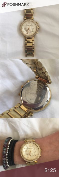 Gold Michael Kors Watch Gold watch from Michael Kors, needs a new battery since I haven't used it for a year. It is well maintained. Michael Kors Accessories Watches