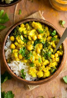 Thai inspired Yellow Cauliflower Chickpea Curry - loaded with tender cauliflower pieces, chickpeas and a quick, homemade yellow curry paste. Only 30 minutes to make! #GlutenFree + #GrainFree + #Vegan #chickpea #chickpeacurry #healthydinner #vegandinner #curry