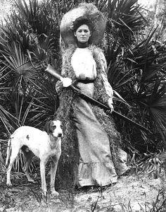 Woman with rifle and dog,1910s  viaFlorida Memory