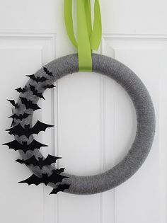 Super cute Halloween yarn wreath. Suggestion in comments to use scraps from an old grey sweatshirt rather than yarn - less tedious, and I certainly have an old grey sweatshirt or two lying around!