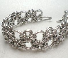 Hodo, the Japanese word for stone path. Interpreted in chainmaille by Rebeca Mojica of Blue Buddha Boutique, this is one of the all time favorites among many chainmaille fans. I recreated this pattern with jump rings of the minimal aspect ratios to give it a cuff-like structure, expressing theunderstated beauty of Zen and the lasting strength of ancient stone path.