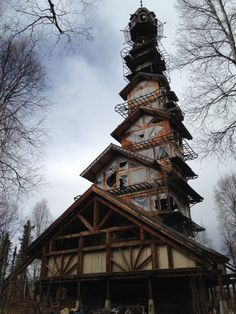 But it's not. It's a real house, built by Alaska Attorney Phillip Weidner. What started as a 40ft x 40ft log cabin has morphed into eight stories. No, we're not...