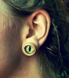 Creature Eye Plugs by ThirdPerception on Etsy. They have human looking eyes too!