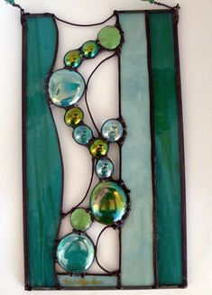 "https://flic.kr/p/fQjWFZ | Turquoise Waters | This lovely 5 1/2""  x  10"" art glass panel is done in turquoises, green  and turquoise glass nuggets.. lots of wire work and decorative soldering..framed in zinc, patinaed black and polished to perfection!  This one also sold at 'Art Walk'."