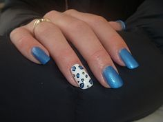 Acrylic with Gelish Gel Polish and some free hand leopard spots