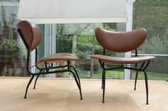 Very early, comfy and light Augusto Bozzi Lounge chairs.      Eras: 1900s / 20th century   Styles: Mid-Century, Italian