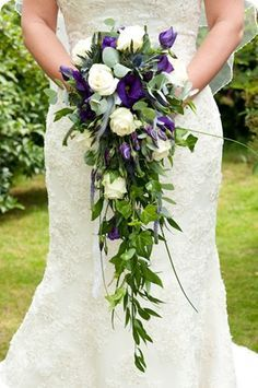 As always, I like the simplicity of this and the line of the bouquet works so well with this dress style.  Carries through the long line of the dress