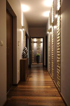 stunning design idea for small hallway in apartment with amazing lighting idea on the wal also vases on wooden vanity as well hardwood flooring