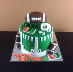 University of Miami Cake   #Football #UM #UniversityOfMiami #RiceKrispiesTreats #Baking #Cake #CakeArt #Sweets #CakeDesign #Buttercream #Vanilla #Frosting #Dessert #Desserts #Food #FoodPics #FoodArt #SugarArt #Fondant #FondantCake #Marshmallow #Handmade #InstaFood