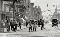 Newsboys at State and High Streets looking south circa 1910.