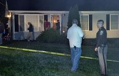 Investigators surround the Culpeper home where a family of five was found shot to death Monday.