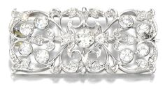 DIAMOND BROOCH, BAILEY, BANKS & BIDDLE CO, 1910S. The rectangular plaque of open work scroll design decorated with circular-cut and rose diamonds, signed to the reverse B.B & B and numbered , later brooch pin, case stamped The Bailey, Banks & Biddle Co.